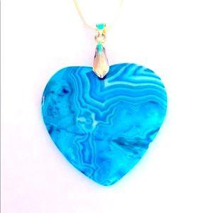 A beautiful blue heart pendant necklace